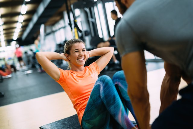 woman training with her personal trainer in the gym