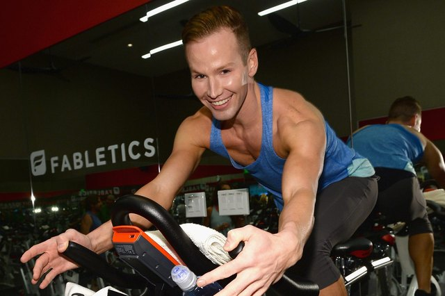 celebrity fitness trainer Jason Wimberly at a JustFab cycling event