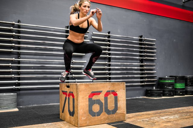 woman doing a box squat in the gym