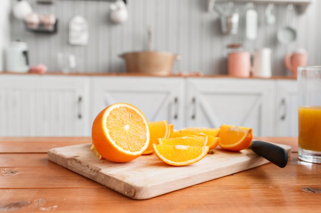 sliced oranges on a wooden cutting board. Healthy and tasty breakfast