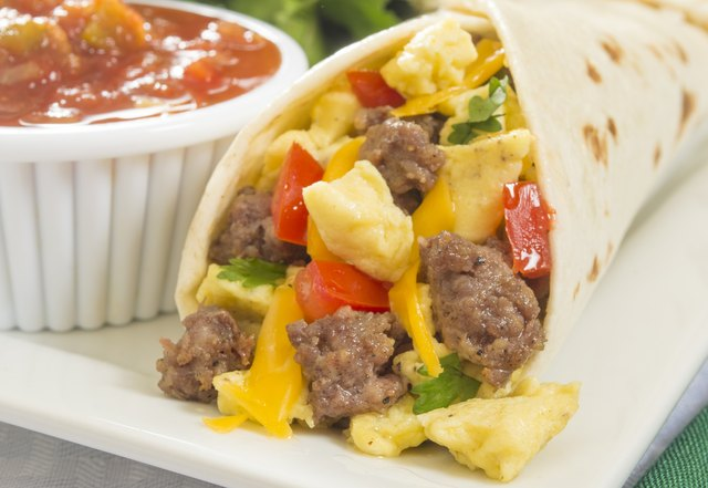 A hot breakfast burrito with egg and sausage