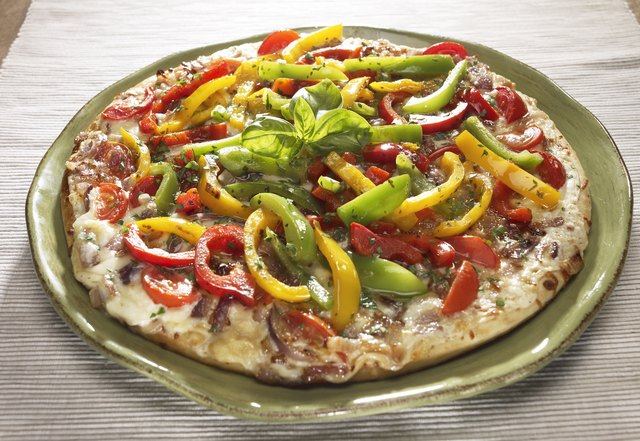 Pizza with peppers and basil