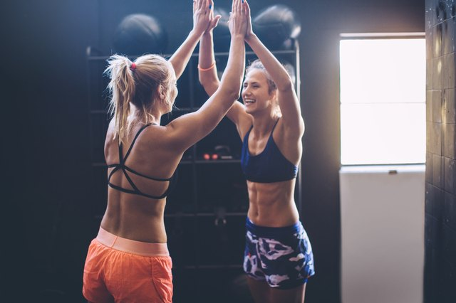 two girls congratulating each other on hitting their fitness goals