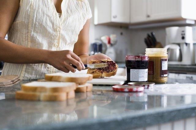Woman Making Sandwiches