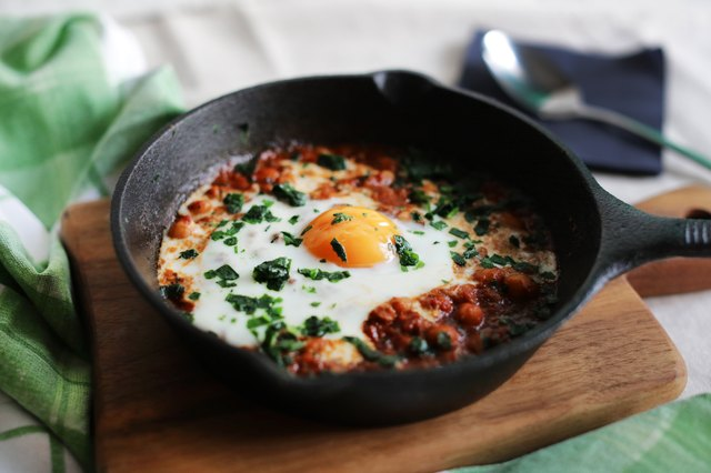 Poached egg in tomato sauce, paprika and spices, arabic shakshouka