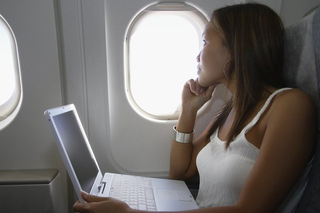 Traveling Woman on a Laptop