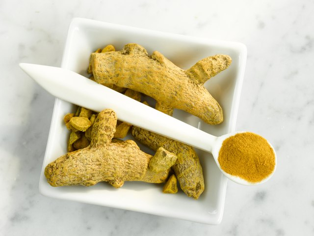 Turmeric roots and turmeric powder, close-up