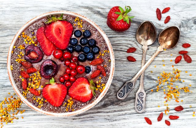 Acai breakfast superfoods smoothies bowl with chia seeds, pollen, goji