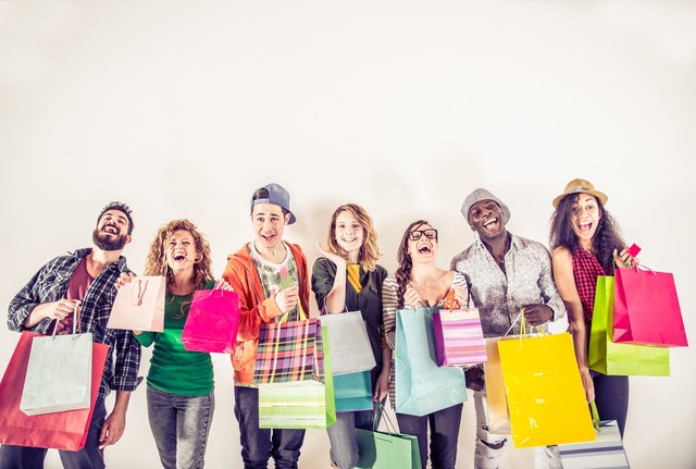 Several people holding shopping bags