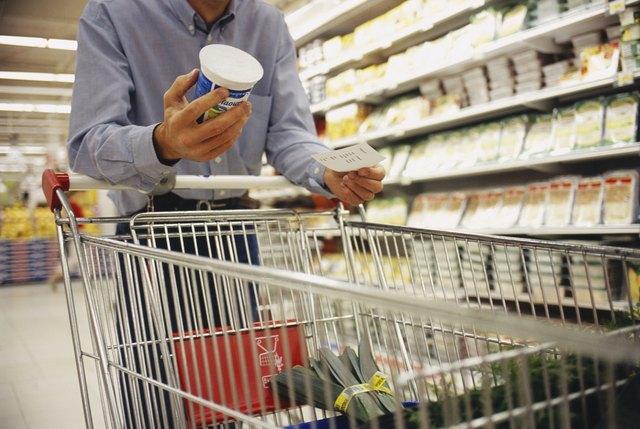 Man Holding Yogurt Pot