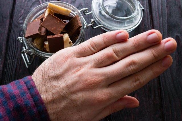 man refuses chocolate selective focus